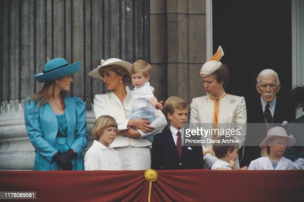 Sarah Duchess of York Diana Princess of Wales Prince Harry and Princess Anne watch the Trooping the Colour ceremony from the balcony of Buckingham...
