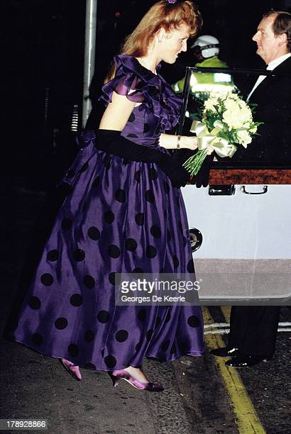 Sarah Duchess of York gets in her car with a bouquet of flowers in 1990 ca in London England