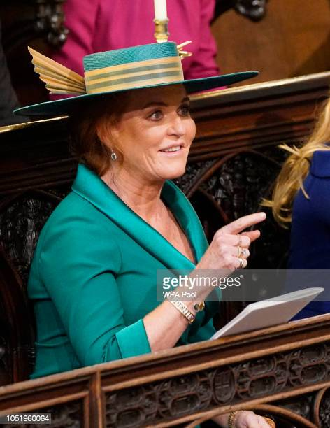 Sarah Duchess of York takes her seat ahead of the wedding of Princess Eugenie to Jack Brooksbank at St George's Chapel in Windsor Castle on October...