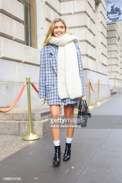 Sarah Ellen is seen wearing a grey grid pattern coat cream knit scarf on the street during New York Fashion Week on February 8 2019 in New York City