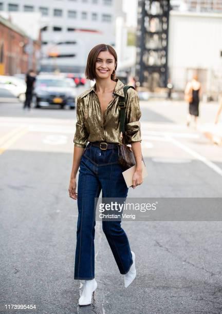 Sarah Ellen is seen wearing denim jeans, golden button shirt outside Michael Kors during New York Fashion Week September 2019 on September 11, 2019...