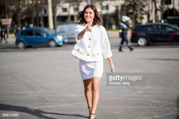 Sarah Ellen pointing her finger wearing jacket and skirt is seen outside Chanel during Paris Fashion Week Womenswear Fall/Winter 2018/2019 on March 6...
