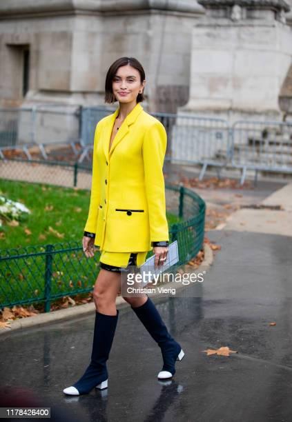 Sarah Ellen seen wearing yellow blazer outside Chanel during Paris Fashion Week Womenswear Spring Summer 2020 on October 01 2019 in Paris France