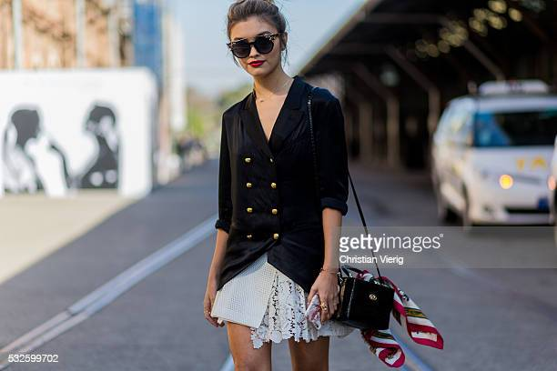 Sarah Ellen wearing a black Burberry blazer Jimmy Choo sunglasses and a white laced skirt at MercedesBenz Fashion Week Resort 17 Collections at...
