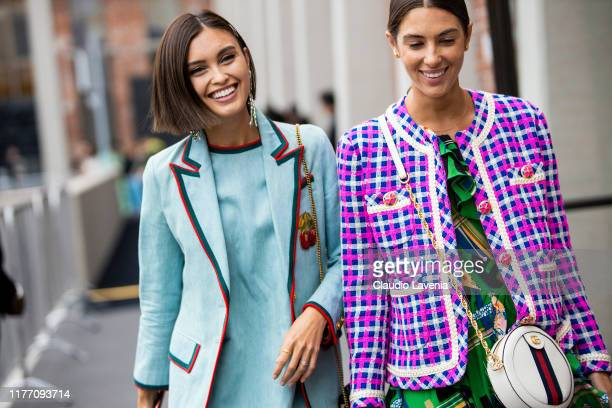 Sarah Ellen , wearing a light blue mini dress with matching blazer, and a guest, wearing a printed dress, decorated jacket and Gucci bag , are seen...
