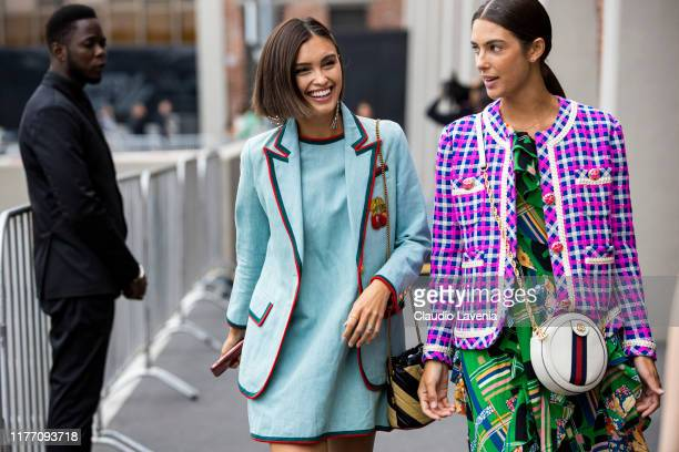 Sarah Ellen , wearing a light blue mini dress with matching blazer, and a guest, wearing a printed dress, decorated jacket and Gucci bag , is seen...