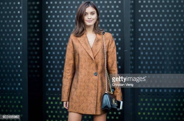 Sarah Ellen wearing jacket Louis Vuitton bag seen outside Gucci during Milan Fashion Week Fall/Winter 2018/19 on February 21 2018 in Milan Italy
