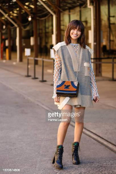 Sarah Ellen wearing Louis Vuitton net top, knit vest, bag and combat boots at Afterpay Australian Fashion Week 2021 on May 31, 2021 in Sydney,...