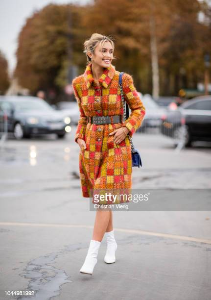 Sarah Ellen wearing orange plaid belted coat blue Chanel bag white ankle boots is seen outside Chanel during Paris Fashion Week Womenswear...