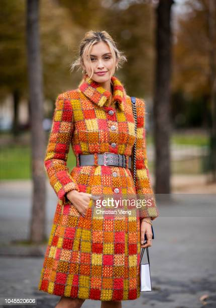 Sarah Ellen wearing orange plaid coat is seen outside Chanel during Paris Fashion Week Womenswear Spring/Summer 2019 on October 2 2018 in Paris France
