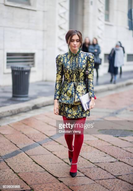Sarah Ellen wearing red stockings seen outside Salvatore Ferragamo during Milan Fashion Week Fall/Winter 2018/19 on February 24 2018 in Milan Italy