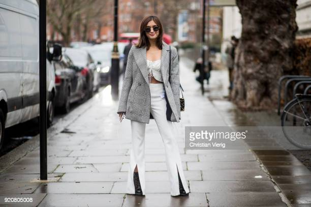 Sarah Ellen wearing white pants grey blazer jacket seen outside Christopher Kane during London Fashion Week February 2018 on February 19 2018 in...