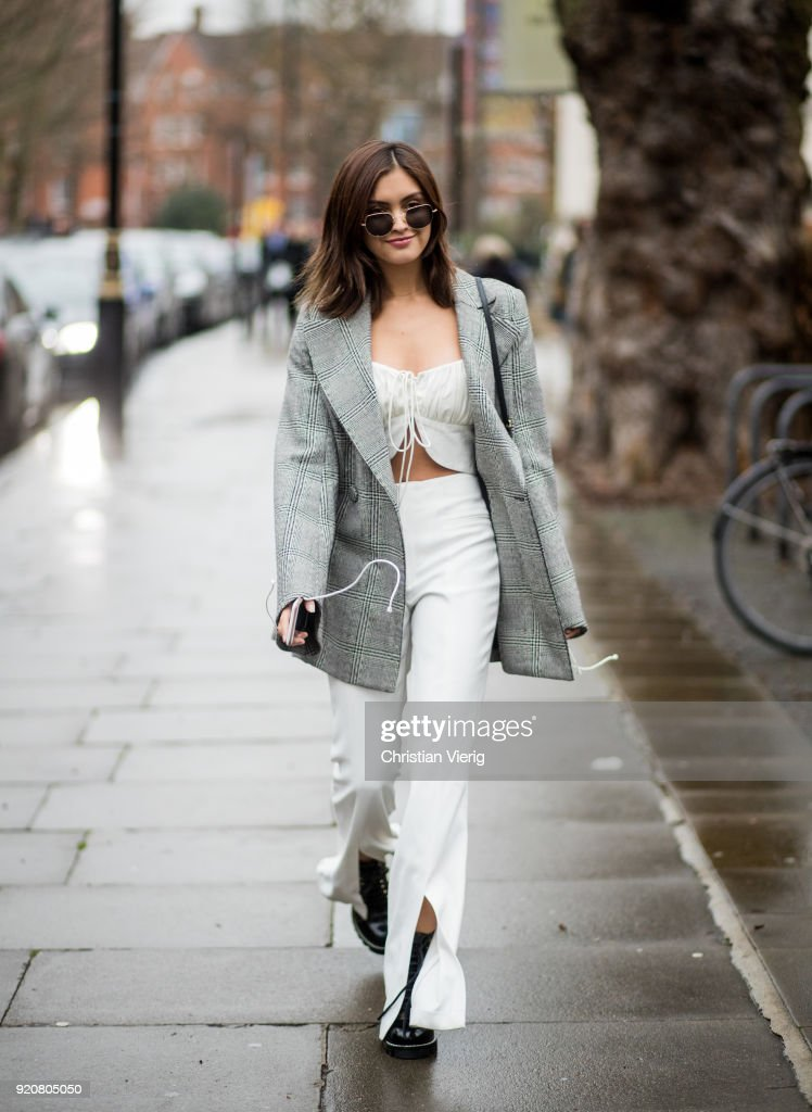 Sarah Ellen wearing white pants, grey blazer jacket seen outside Christopher Kane during London Fashion Week February 2018 on February 19, 2018 in London, England.