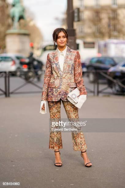 Sarah Ellen wears a white shirt a multi color print pattern blazer jacket and suit outside Miu Miu during Paris Fashion Week Womenswear Fall/Winter...