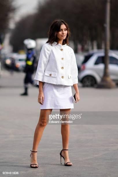 Sarah Ellen wears a white tweed jacket a white dress high heels shoes outside Chanel during Paris Fashion Week Womenswear Fall/Winter 2018/2019 on...