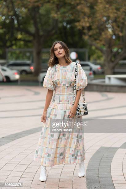 Sarah Ellen wears an Aje dress and Prada handbag at the Melbourne Fashion Festival at the National Gallery of Victoria on March 11, 2021 in...