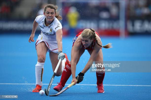 Sarah Evans of Great Britain battles with Sophie Limauge of Belgium during the Women's FIH Field Hockey Pro League match between Great Britain and...