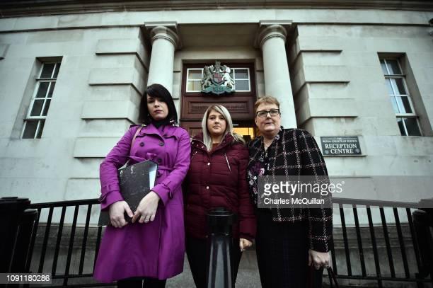 Sarah Ewart her mother Jane Christie and Grainne Teggart from Amnesty International pose outside the High Court on January 30 2019 in Belfast...