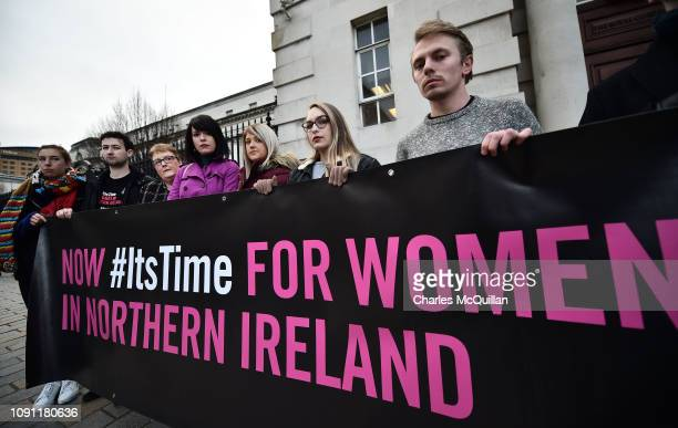 Sarah Ewart her mother Jane Christie and Grainne Teggart from Amnesty International pose with pro choice protestors outside the High Court on January...