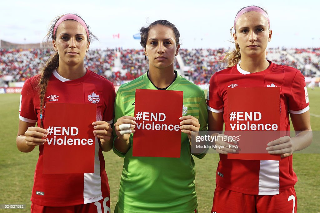 Sarah Feola #16 of Canada, Panagiota Koutoulas #21 and Marie Levasseur #7 stand with cards promoting the #ENDviolence campaign after their Group B match in the FIFA U-20 Women's World Cup Papua New Guinea against Japan on November 20, 2016 at National Football Stadium in Port Moresby, Papua New Guinea.
