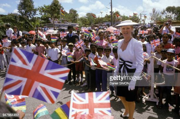 Sarah Ferguson Duchess of York acclaimed by the crowd holding British flags during official visit with husband Prince Andrew in September 1987 in...