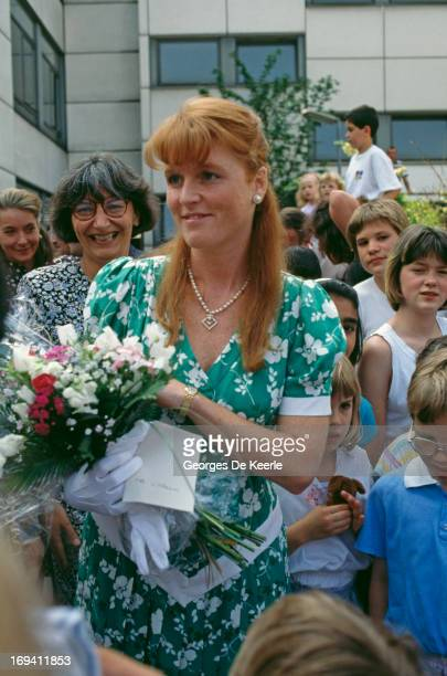 Sarah Ferguson Duchess of York among fans holding a bouquet on a trip to Berlin 25th May 1989