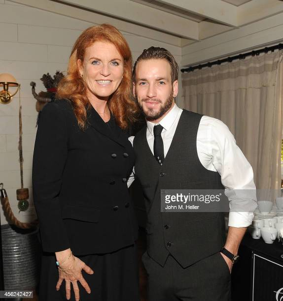 Sarah Ferguson Duchess of York and actor Will Rothhaar pose before the British American Business Council's 54th Annual Los Angeles Christmas Luncheon...