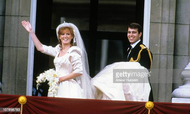 Sarah Ferguson Duchess of York and Prince Andrew Duke of York stand on the balcony of Buckingham Palace and wave at their wedding on July 23 1986 in...