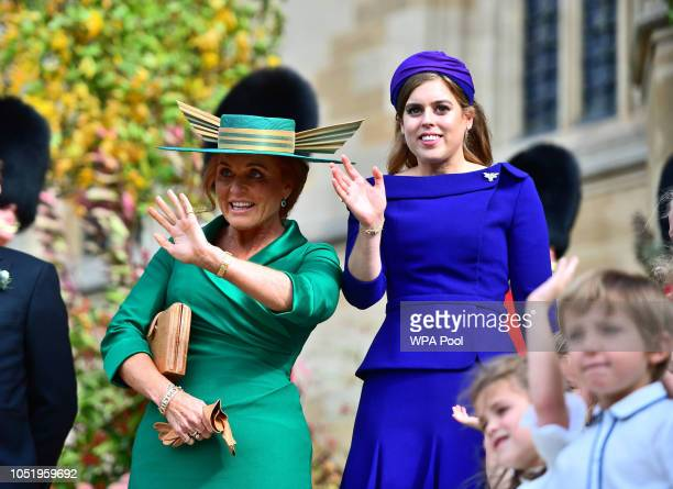 Sarah Ferguson Duchess of York and Princess Beatrice of York attend the wedding of Princess Eugenie of York to Jack Brooksbank at St George's Chapel...