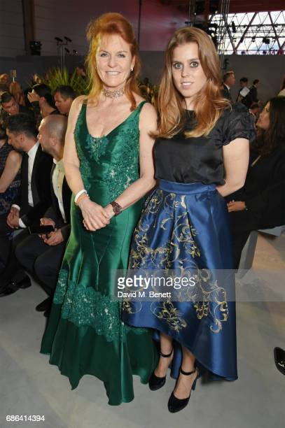 Sarah Ferguson Duchess of York and Princess Beatrice of York attend the Fashion for Relief event during the 70th annual Cannes Film Festival at...
