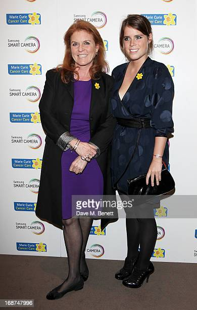 Sarah Ferguson Duchess of York and Princess Eugenie of York attend the launch of Samsung's NX Smart Camera at a charity auction with David Bailey in...