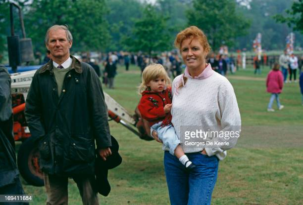 Sarah Ferguson Duchess of York carries her daughter Princess Beatrice of York at the Royal Windsor Horse Show 12th May 1990