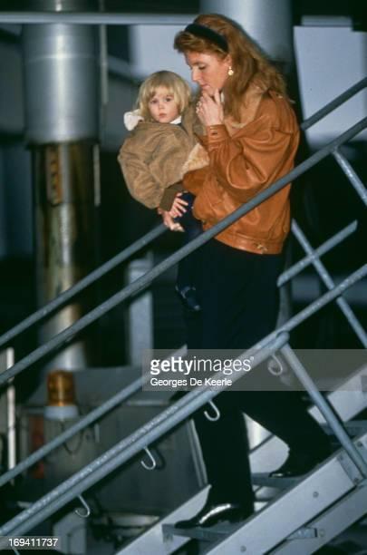 Sarah Ferguson Duchess of York carries her daughter Princess Beatrice of York Klosters Switzerland January 1991