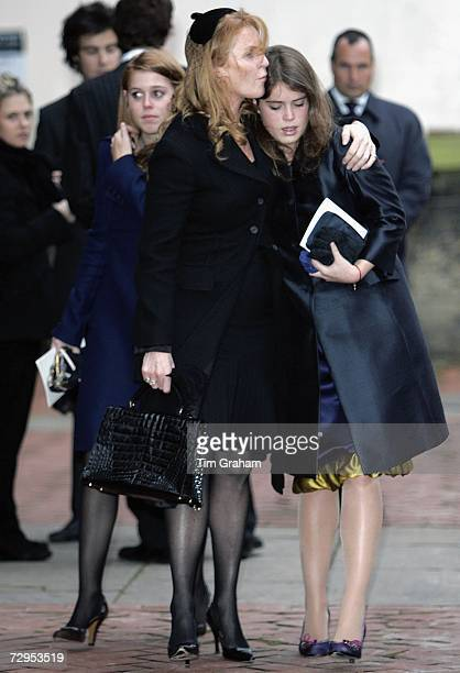 Sarah Ferguson Duchess of York comforts her daughters Princess Beatrice and Princess Eugenie at a Thanksgiving Service for the life of their close...