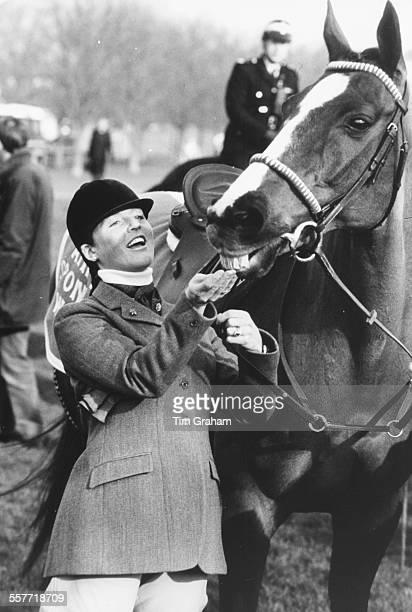 Sarah Ferguson Duchess of York feeding the horse 'Aldaniti' winner of the 1981 Grand National at a charity race in Windsor March 3rd 1987