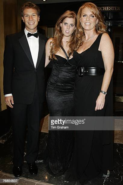 Sarah Ferguson Duchess of York in her role as founder and president of the Children in Crisis charity with her daughter Princess Beatrice and...