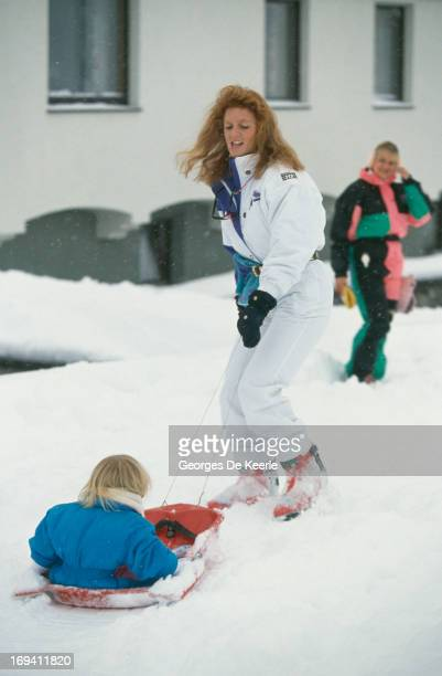 Sarah Ferguson Duchess of York pulls her daughter Princess Beatrice of York in the snow during a skiing trip to Klosters Switzerland 12th January 1991