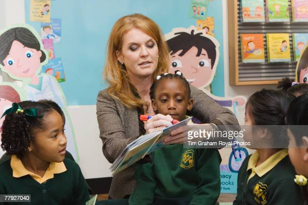 Sarah Ferguson Duchess of York signs one of her books for local school children at the release of her new series of children's books entitled...