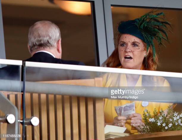 Sarah Ferguson Duchess of York talks with Prince Andrew Duke of York whilst holding a wad of cash and betting slips as she attends day four of Royal...