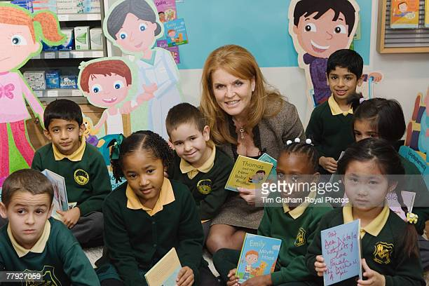 Sarah Ferguson Duchess of York with local school children at the release of her new series of children's books entitled 'Helping Hands' which serve...