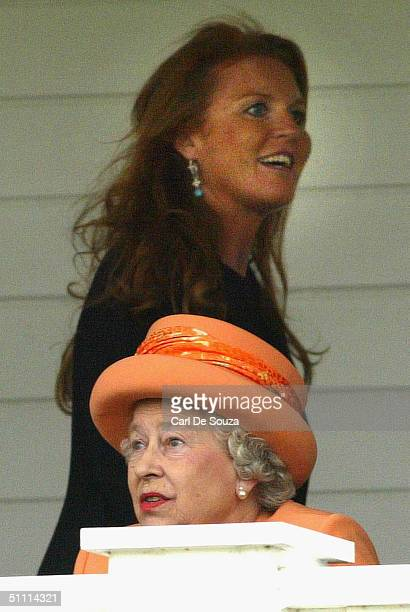 Sarah Ferguson the Duchess of York passes Queen Elizabeth II as she spectates at the Guards Polo Club on July 25 2004 in Windsor England