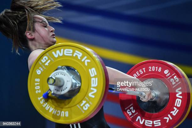 Sarah Fischer of Austria lifts during the women's senior 90 kg category of the European Weightlifting Championship in Izvorani, Romania, on March 31,...