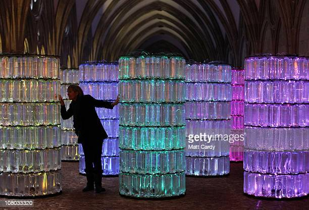 Sarah Flanagan inspects WaterTowers Bruce Munro's newest light and sound installation in Salisbury Cathedral's medieval cloisters on January 13 2011...