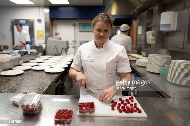 Sarah Frankland seen cutting raspberries in her pastry kitchen at the Pennyhill Park hotel where she is the head pastry chef during the Show. Sarah...