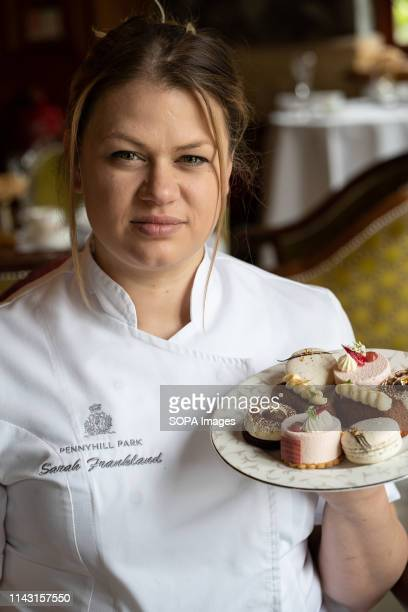 Sarah Frankland seen holding a plate of dessert at the Pennyhill Park hotel where she is the head pastry chef during the Show Sarah is currently a...