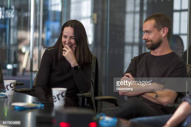 Sarah Friar chief financial officer of Square Inc left laughs as Jack Dorsey cofounder and chief executive officer of Twitter Inc listens during an...