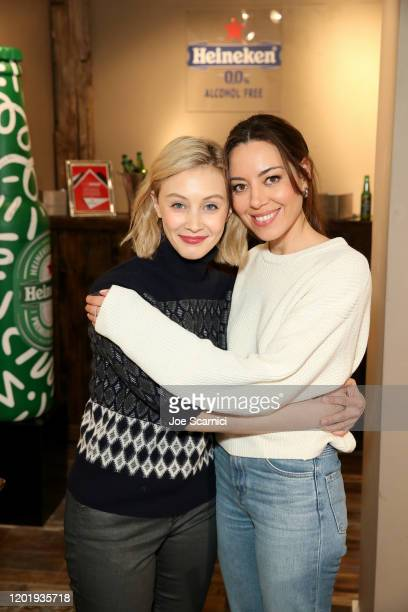 "Sarah Gadon and Aubrey Plaza of ""Black Bear"" signs the Heineken bottle sculpture at TheWrap Studio at Sundance Film Festival on January 25, 2020 in..."
