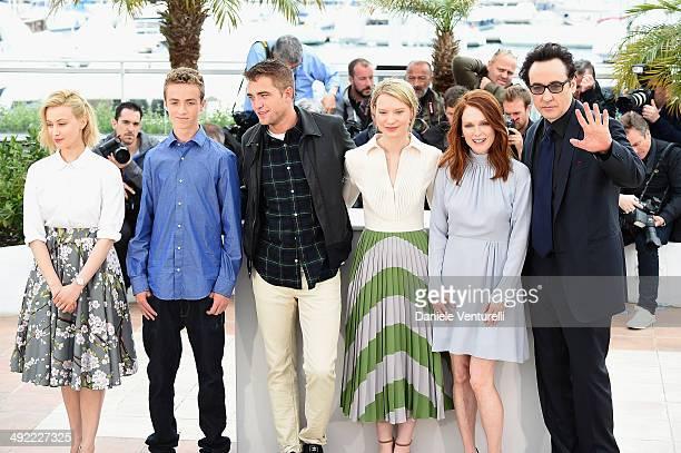 Sarah Gadon Evan Bird Robert Pattinson Mia Wasikowska Julianne Moore and John Cusack attend the 'Maps To The Stars' photocall at the 67th Annual...