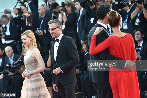 Sarah Gadon Laurent Vinay and Lorenzo Tonetti attend the Opening Ceremony and 'Birdman' premiere during the 71st Venice Film Festival at Palazzo Del...