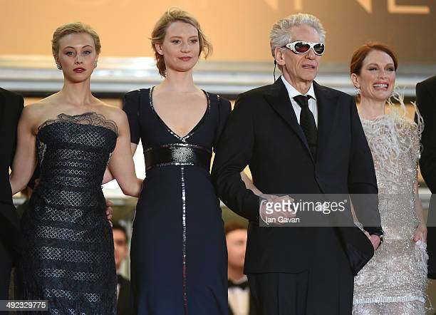 Sarah Gadon Mia Wasikowska David Cronenberg and Julianne Moore attends the Maps To The Stars premiere during the 67th Annual Cannes Film Festival on...
